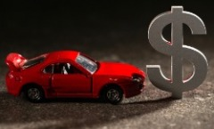A toy car next to a dollar symbol.